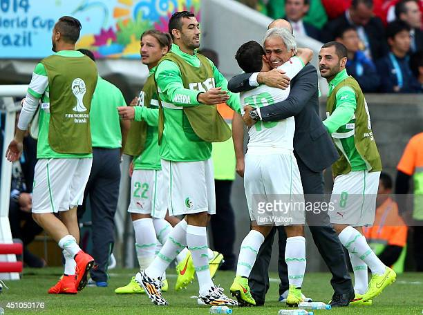 Abdelmoumene Djabou of Algeria celebrates scoring his team's third goal by hugging head coach Vahid Halilhodzic during the 2014 FIFA World Cup Brazil...