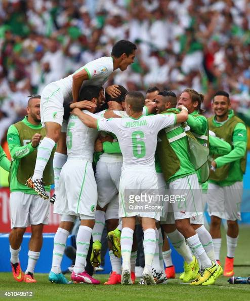Abdelmoumene Djabou of Algeria celebrates scoring his team's third goal with teammates during the 2014 FIFA World Cup Brazil Group H match between...