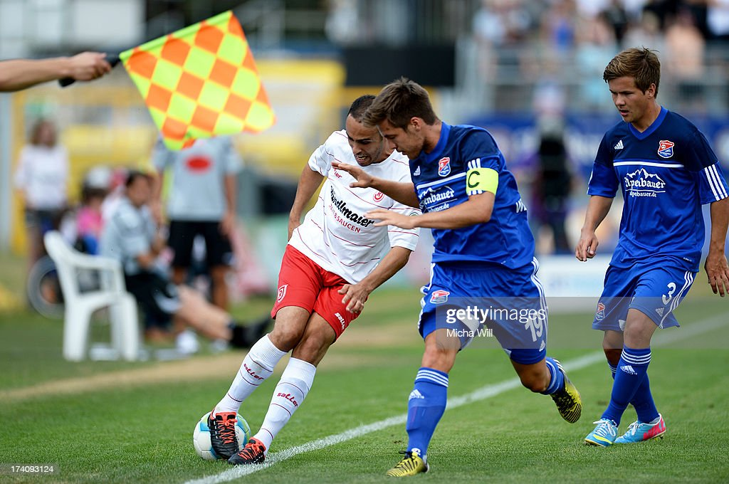 Abdenour Amachaibou (L) of Regensburg is challenged by Maximilian Welzmueller (C) and <a gi-track='captionPersonalityLinkClicked' href=/galleries/search?phrase=Fabian+Goetze&family=editorial&specificpeople=3391135 ng-click='$event.stopPropagation()'>Fabian Goetze</a> of Unterhaching during the Third League match between Jahn Regensburg and SpVgg Unterhaching at Jahnstadion on July 20, 2013 in Regensburg, Germany.