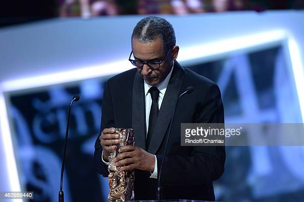 Abderrahmane Sissako receives an award for Best Director for his film 'Timbuktu ' during the 40th Cesar Film Awards 2015 Ceremony at Theatre du...