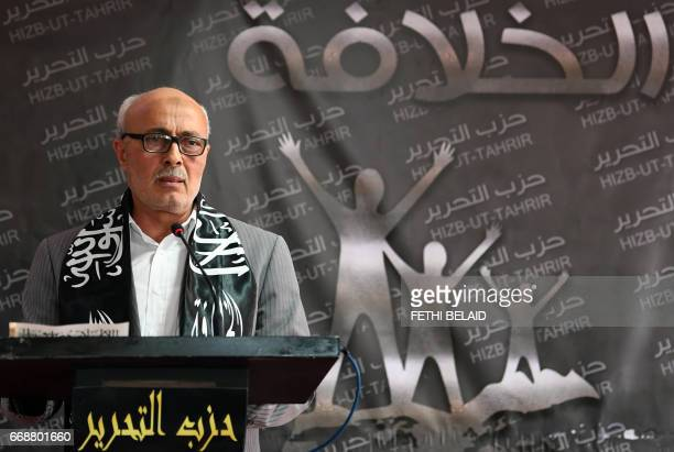 Abderraouf Amri head of the Political Bureau for the radical Islamist party Hizb utTahrir delivers a speech at the party headquarters on April 15 in...
