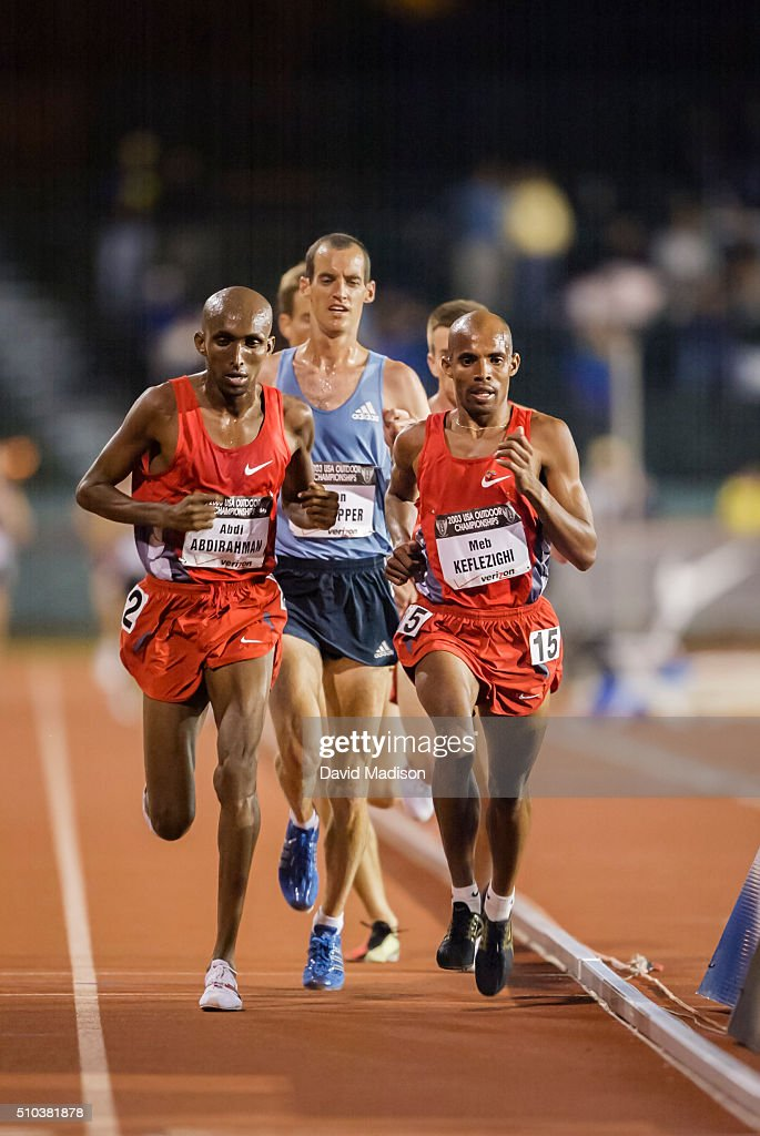 Abdi Abdirahman, Alan Culpepper (in blue), and Meb Keflezighi of the USA compete in the Men's 10000 meter event of the 2003 USA Track and Field Outdoor Championships on June 19, 2003 at Stanford University in Palo Alto, California.