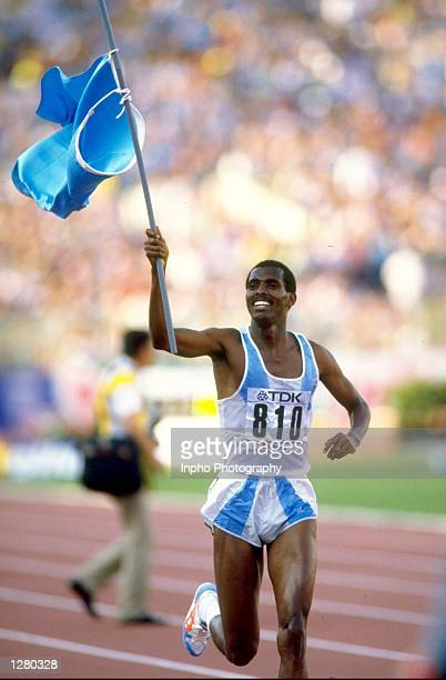 Image result for Abdi Bile waving Somali Flag