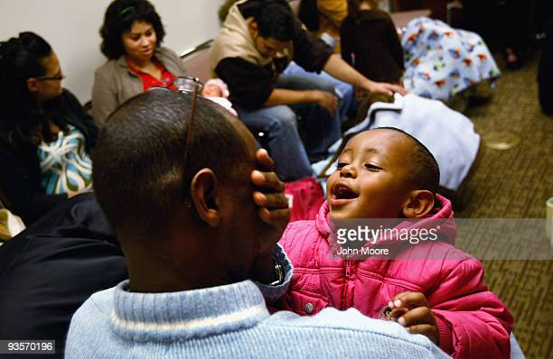 Abdi Mohammed an immigrant from Somalia plays with his elder son Sabir at a newborn care class at a community health center for lowincome patients on...