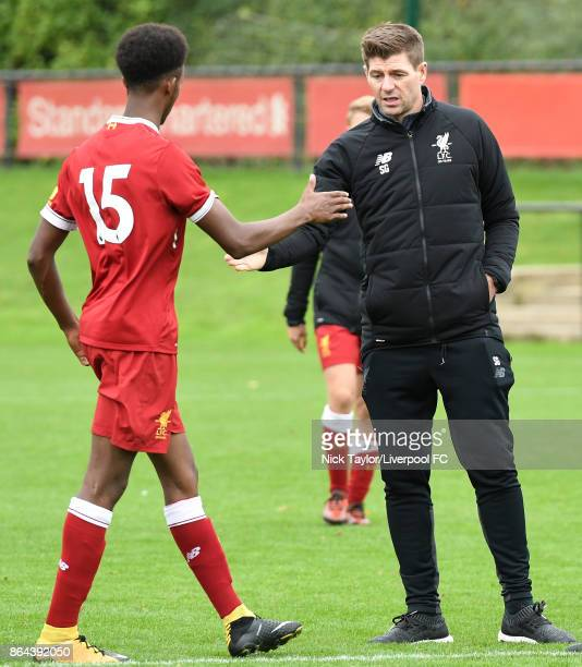 Abdi Sharif of Liverpool with Liverpool U18 coach Steven Gerrard after the Liverpool v West Bromwich Albion U18 Premier League game at The Kirkby...