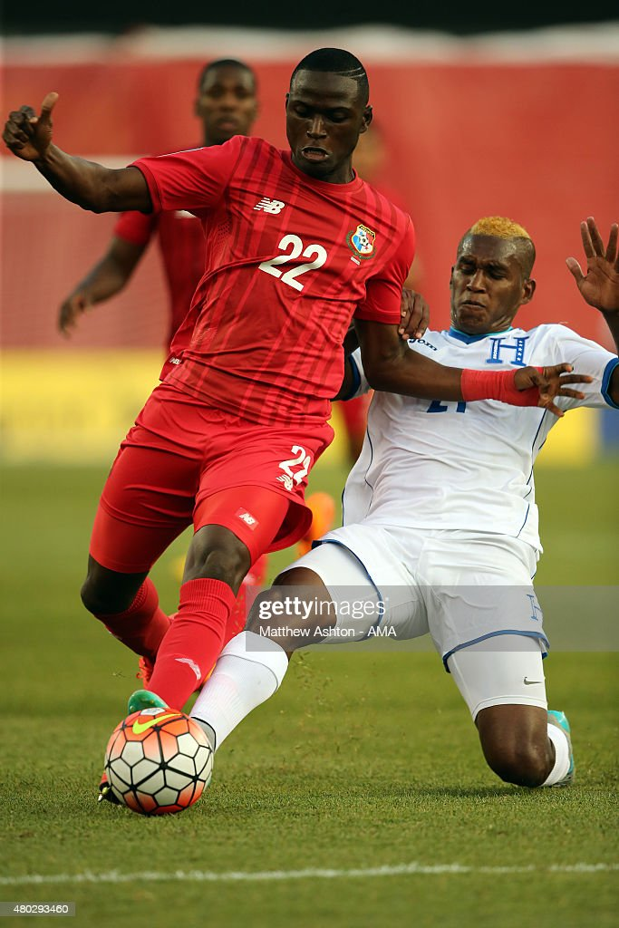 Abdiel Arroyo of Panama gets tackled by Brayan Beckeles of Honduras during the CONCACAF Gold Cup match between Honduras and Panama at Gillette Stadium on July 10, 2015 in Foxboro, Massachusetts.