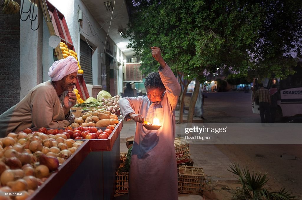 Abdo Al Assiuiti, sells fruits and vegetables in the center of Abu Simbal, March 14, 2012. Each night a young man comes around with incense. Abu Simbel is a one of the southern most villages in Egypt. It is most famous for its remains from Ancient Egypt, but it also draws Egyptians from across the country to work and make their dreams in its farms and jobs.