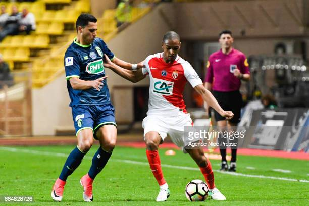Abdou Diallo of Monaco and Carlens Arcus of Lille during the French National Cup Quarter Final match between Monaco and Lille at Stade Louis II on...