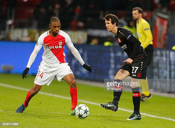 Abdou Diallo of Monaco and Robbie Kruse of Leverkusen battle for the ball during the UEFA Champions League match between Bayer Leverkusen and AS...