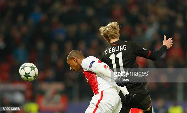 Abdou Diallo of Monaco and Stefan Kiessling of Leverkusen battle for the ball during the UEFA Champions League match between Bayer Leverkusen and AS...