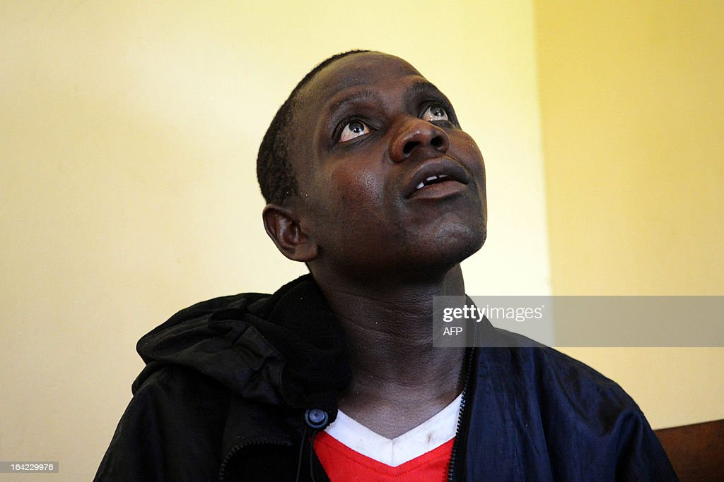 Abdou Fataou of Togo, one of the eight survivors among the passengers of the boat which capsized off the Gabonese capital Libreville, waits at the Gendarmerie in Cape Esterias, on March 21, 2013. At least 30 people died in the accident. Police said the boat, which was carrying 65 people thought to be illegal immigrants, capsized in stormy weather overnight as it was travelling from Nigeria to Libreville. AFP journalists counted 30 bodies lying along the shore, with the boat still visible in the waters of Cape Esterias, which lies about 40 kilometres (25 miles) north of Libreville.