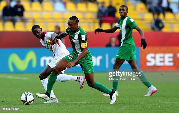 Abdoul Dante of Mali and Kelechi Nwakali of Nigeria battle for the ball during the FIFA U17 Men's World Cup 2015 final match between Mali and Nigeria...