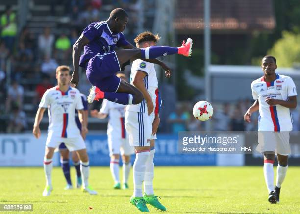 Abdoul Dante of RSC Anderlecht clears the ball as Amine Gouiri of Olympique Lyonnais closes in during the Final match between Olympique Lyon vs RSC...