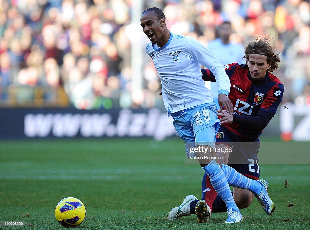 Abdoulay Konko (L) of S.S. Lazio is tackled by Thomas Manfredini of Genoa during the Serie A match between Genoa CFC and SS Lazio at Stadio Luigi Ferraris on February 3, 2013 in Genoa, Italy.