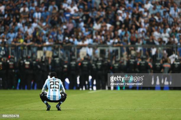 Abdoulaye Ba of 1860 Muenchen looks dejected after the Second Bundesliga Playoff second leg match betweenTSV 1860 Muenchen and Jahn Regensburg at...