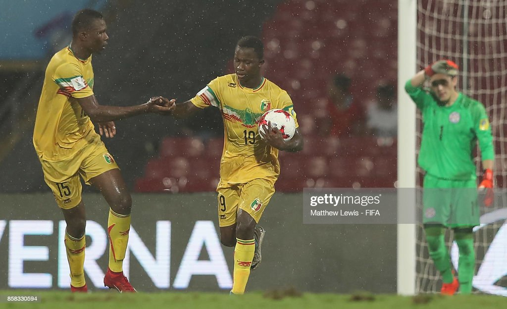 Abdoulaye Diaby of Mali congratulates Lassan Ndiaye of Mali on his goal during the FIFA U-17 World Cup India 2017 group B match between Paraguay and Mali at Dr DY Patil Cricket Stadium on October 6, 2017 in Mumbai, India.