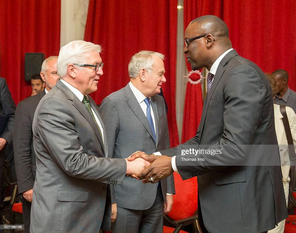 Abdoulaye Diop, Foreign Minister of Mali (R) welcomes German Foreign Minister Frank-Walter Steinmeier (L) and Foreign Minister of France Marc Ayrault (C) on May 02, 2016 in Bamako, Mali. Steinmeier and Ayrault visit Mali and Niger for political conversations.