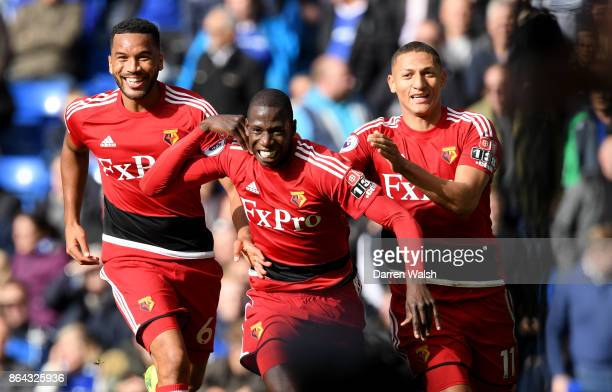 Abdoulaye Doucoure celebrates scoring his side's first goal with Adrian Mariappa and Richarlison de Andrade of Watford during the Premier League...