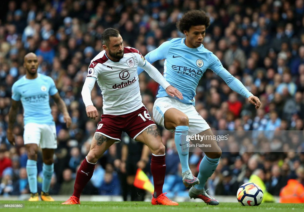 Abdoulaye Doucoure of Watford and Leroy Sane of Manchester City battle for the ball during the Premier League match between Manchester City and Burnley at Etihad Stadium on October 21, 2017 in Manchester, England.
