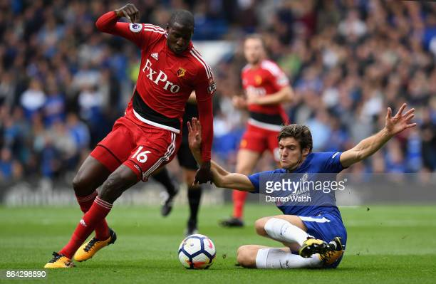Abdoulaye Doucoure of Watford and Marcos Alonso of Chelsea during the Premier League match between Chelsea and Watford at Stamford Bridge on October...
