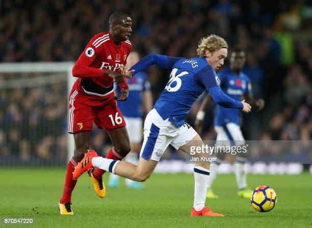 Abdoulaye Doucoure of Watford and Tom Davies of Everton battle for possession during the Premier League match between Everton and Watford at Goodison...