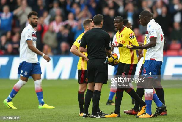 Abdoulaye Doucoure of Watford argues with referee Michael Oliver during the Premier League match between Watford and Stoke City at Vicarage Road on...