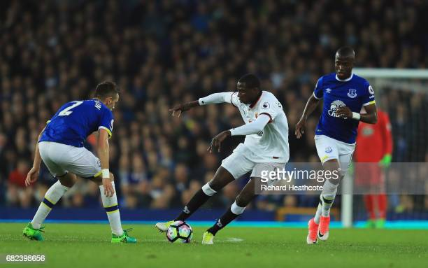 Abdoulaye Doucoure of Watford attempts to get past Morgan Schneiderlin of Everton during the Premier League match between Everton and Watford at...