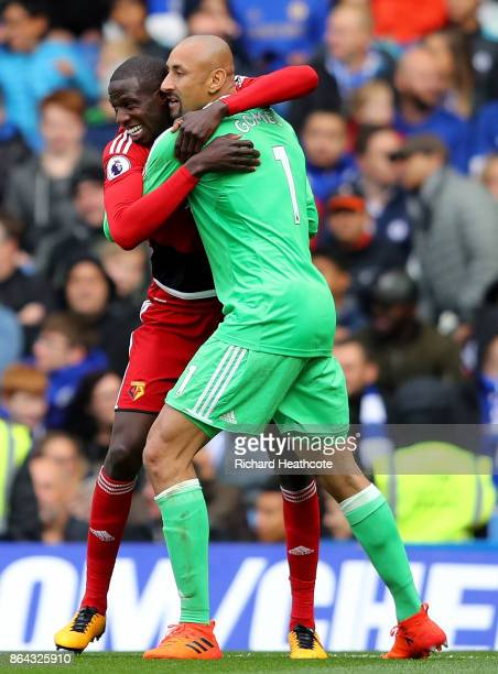 Abdoulaye Doucoure of Watford celebrates with Heurelho Gomes of Watford after scoring his sides first goal during the Premier League match between...