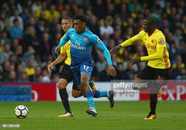 Abdoulaye Doucoure of Watford chases down Alex Iwobi of Arsenal during the Premier League match between Watford and Arsenal at Vicarage Road on...