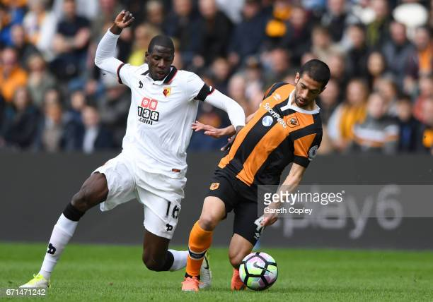 Abdoulaye Doucoure of Watford closes down Evandro of Hull City during the Premier League match between Hull City and Watford at the KCOM Stadium on...