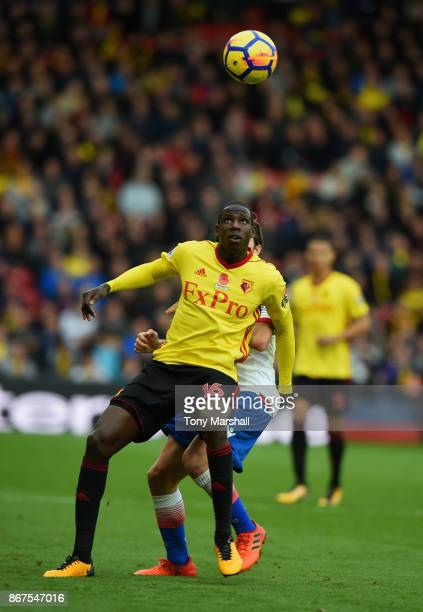 Abdoulaye Doucoure of Watford holds off a challenge from Joe Allen of Stoke City during the Premier League match between Watford and Stoke City at...