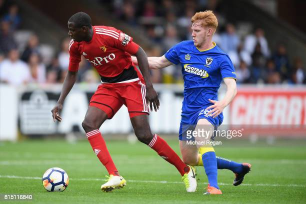 Abdoulaye Doucoure of Watford in action with Alfie Egan of Wimbledon during the preseason friendly match between AFC Wimbledon and Watford at The...