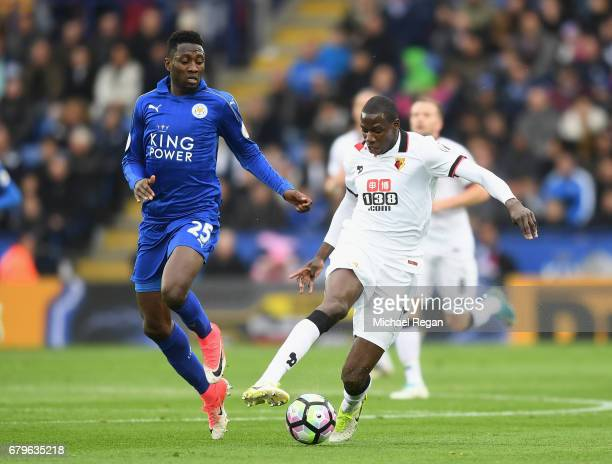 Abdoulaye Doucoure of Watford is put under pressure from Wilfred Ndidi of Leicester City during the Premier League match between Leicester City and...