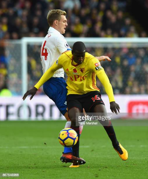 Abdoulaye Doucoure of Watford is tackled by Darren Fletcher of Stoke City during the Premier League match between Watford and Stoke City at Vicarage...