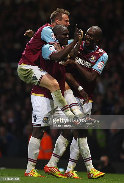 Abdoulaye Faye is congratulated by Carlton Cole and Matt Taylor of West Ham after scoring the first goal during the npower Championship match between...