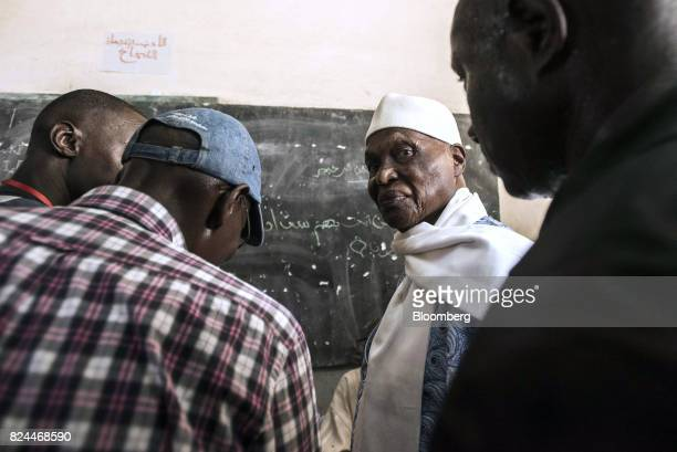 Abdoulaye Wade former Senegalese president and leader of the Democratic Party arrives to cast his vote at a polling station during parliamentary...