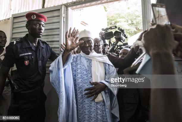 Abdoulaye Wade former Senegalese president and leader of the Democratic Party waves as he arrives to cast his vote at a polling station during...