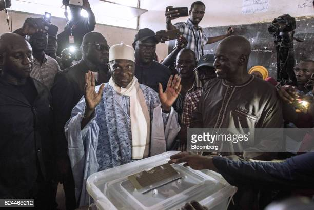 Abdoulaye Wade former Senegalese president and leader of the Democratic Party center gestures after casting his vote in a ballot box at a polling...