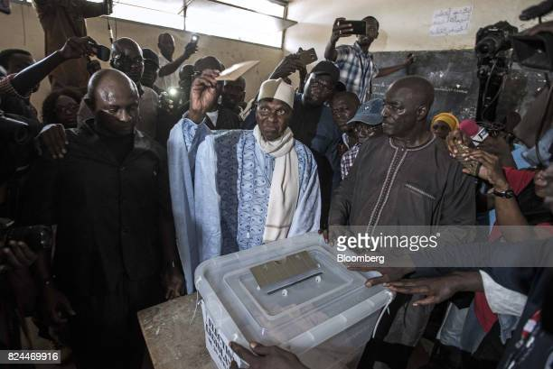Abdoulaye Wade former Senegalese president and leader of the Democratic Party center casts his vote at a polling station during parliamentary...