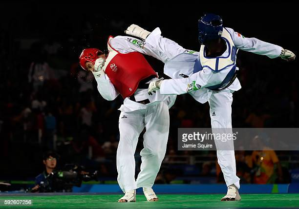 Abdoulrazak Issoufou Alfaga of Niger competes against Radik Isaev of Azerbaijan during the Men's 80kg Gold Medal contest on Day 15 of the Rio 2016...