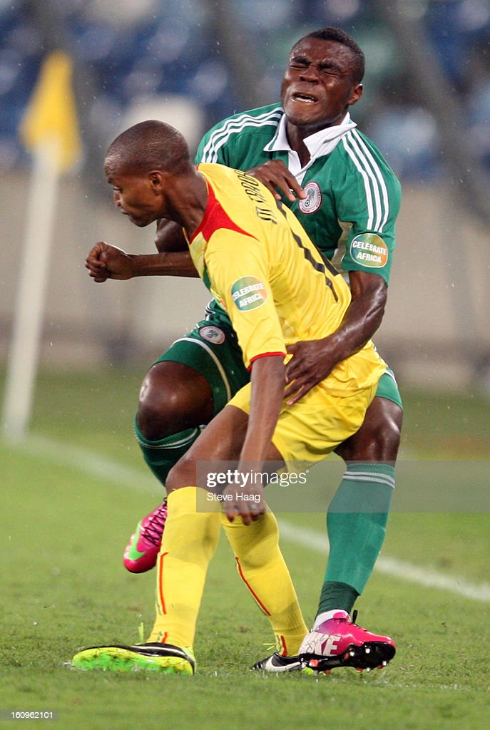 Abdrahamane Traore of Mali clashes with Emmanuel Emenike of Nigeria during the 2013 African Cup of Nations Semi-Final match between Mali and Nigeria at Moses Mahbida Stadium on February 06, 2013 in Durban, South Africa.