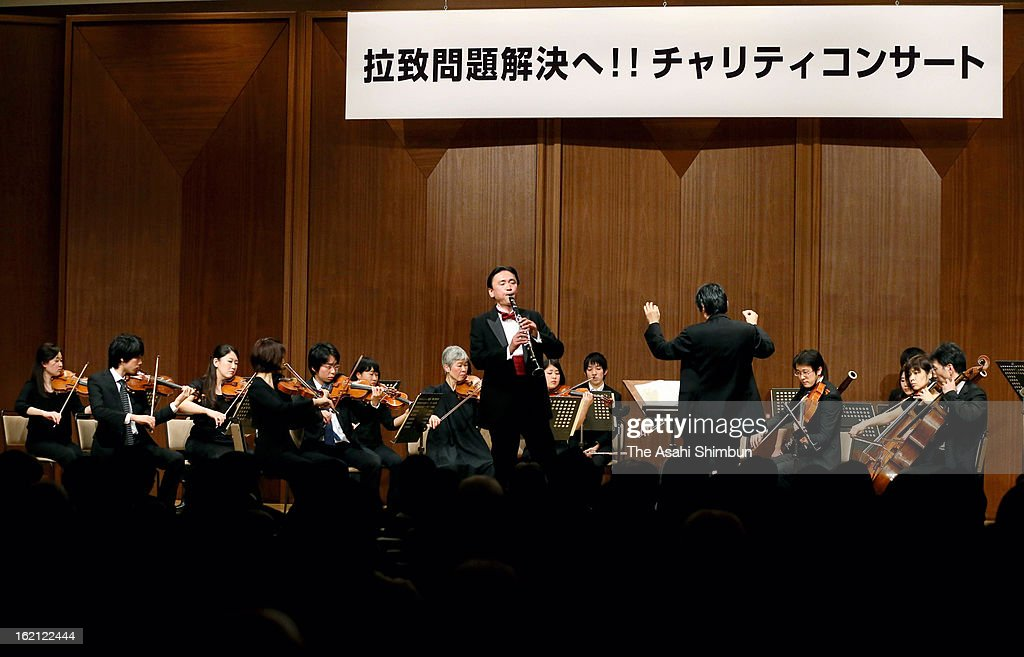 Abduction Issue Minister Keiji Furuya performs clarinet during the charity concert to seek the resolution of abductees problems at Suntory Hall on February 18, 2013 in Tokyo, Japan.