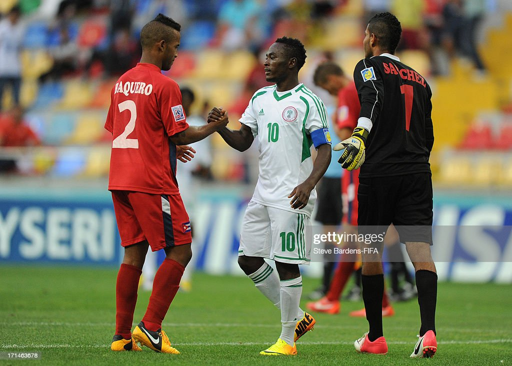 Abdul Ajagun of Nigeria shakes hands with Andy Baquero of Cuba after the FIFA U-20 world Cup Group B match between Cuba and Nigeria at Kadir Has Stadium on June 24, 2013 in Kayseri, Turkey.