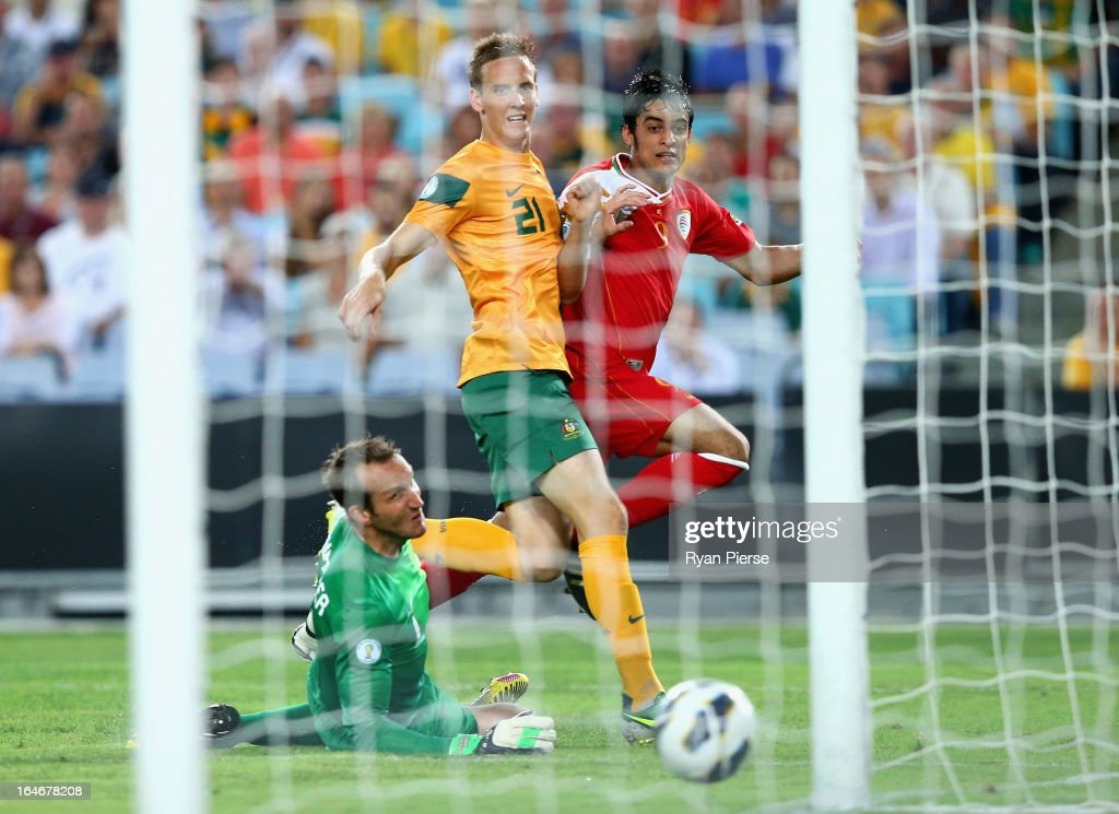 Abdul Aziz of Oman scores his team's first goal past Mark Schwarzer of the Socceroos during the FIFA 2014 World Cup Qualifier match between the Australian Socceroos and Oman at ANZ Stadium on March 26, 2013 in Sydney, Australia.
