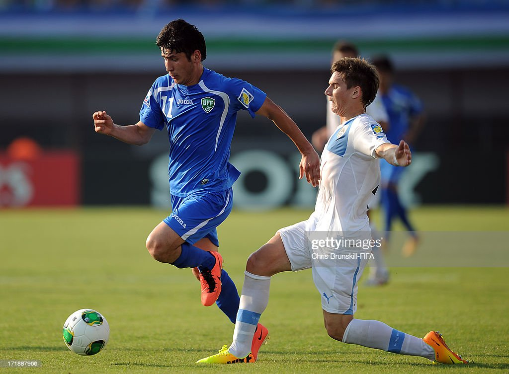 Abdul Aziz Yusupov (L) of Uzbekistan is challenged by Guillermo Varela of Uruguay during the FIFA U20 World Cup Group F match between Ukbekistan and Uruguay at Akdeniz University Stadium on June 29, 2013 in Antalya, Turkey.