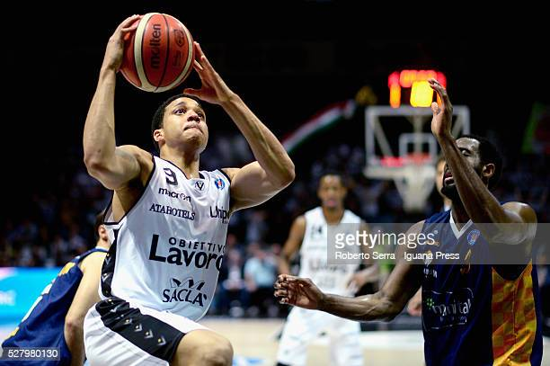 Abdul Gaddy of Obiettivo Lavoro competes with DJ White of Manital during the LegaBasket match between Virtus Obiettivo Lavoro Bologna v Auxilium...