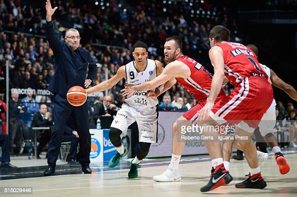 Abdul Gaddy of Obiettivo Lavoro competes with Milan Macvan and Mantas Kalnietis of EA7 during the LegaBasket match between Virtus Obiettivo Lavoro...