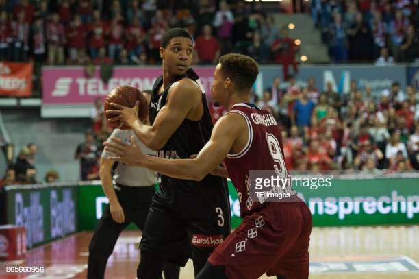 Abdul Gaddy of Wuerzburg and Jared Cunningham of Bayern Muenchen battle for the ball during the easyCredit BBL Basketball Bundesliga match between FC...