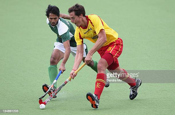 Abdul Haseem Khan of Pakistan and Alex Fabregas of Spain in action during the match between Spain and Pakistan on day two of the 2011 Men's Champions...