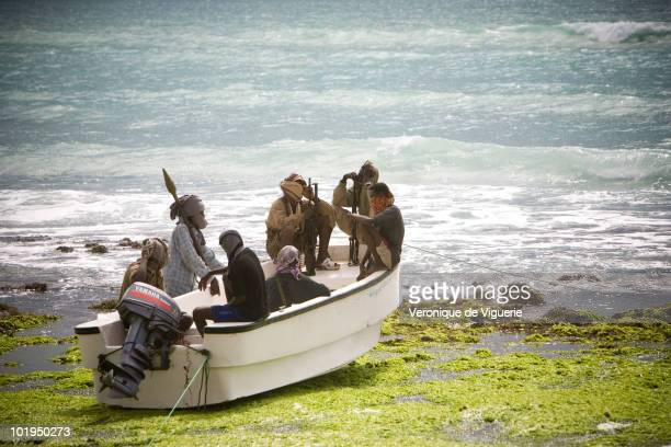 Abdul Hassan carries an RPG on a small boat with some of his crew He is nicknamed 'the one who never sleeps' and is a chief of the pirate group...